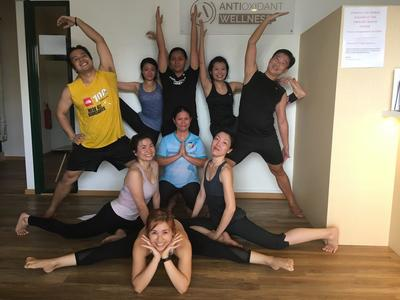 Hot Infrared Yoga - Students posing after class